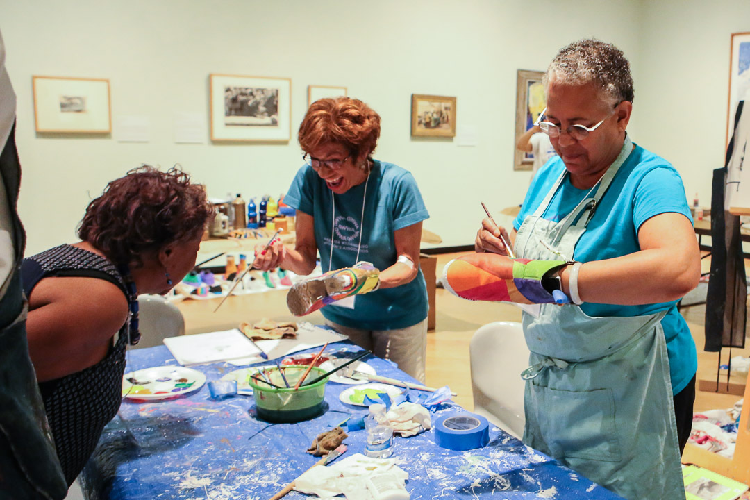 Volunteers assist with our Cultural Arts Experience event. Photo by Lex Rowland.