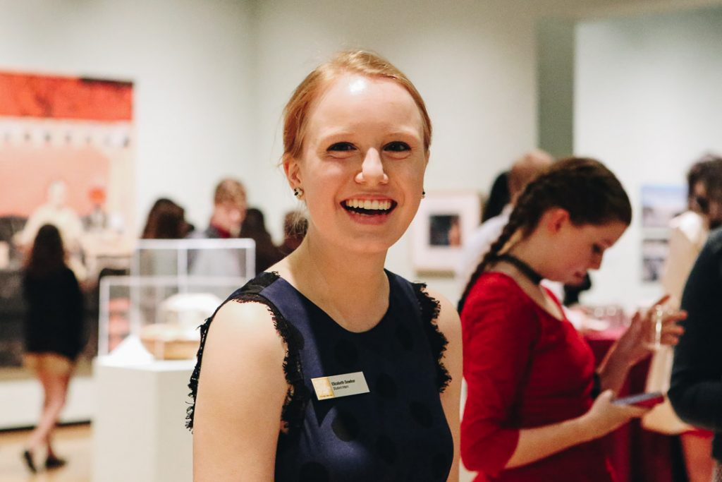 "Museum intern at the student opening for our 2018 exhibition ""Women With Vision: Masterworks from the Permanent Collection."" Photo by Lex Rowland."