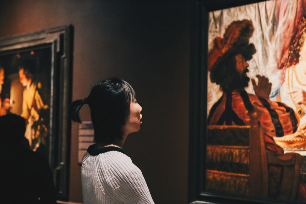 """Visitor to our 2018 exhibition """"In the Light of Caravaggio: Dutch and Flemish Paintings from Southeastern Museums."""" Photo by Lex Rowland."""